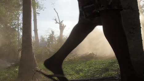 Legs-Walking-Past-Dust-Cloud-in-a-Forest