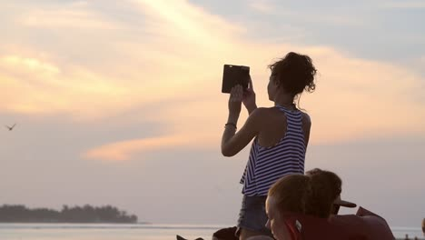 Woman-Taking-a-Panorama-Shot-of-the-Sea