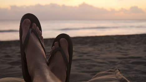 POV-Shot-of-Feet-on-a-Beach
