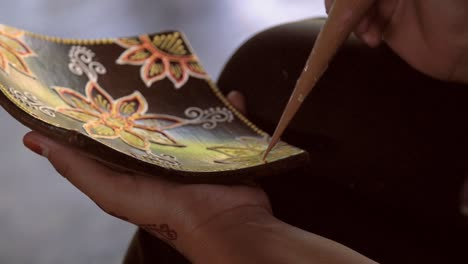 Close-Up-of-Hands-Decorating-a-Dish