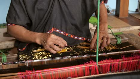 Woman-Weaving-on-a-Back-Strap-Loom
