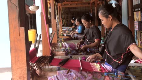 Woman-Weaving-in-a-Workshop
