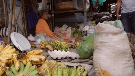 Woman-Sitting-at-a-Banana-Market-Stall