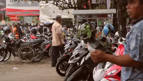 Man-Standing-by-a-Row-of-Motorcycles