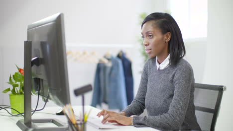 Young-Female-Professional-Working-at-Desk-2