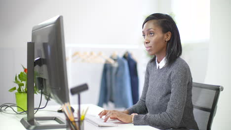 Young-Female-Professional-Working-at-Desk-4