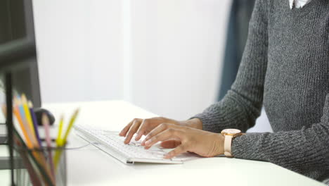 Young-Woman-Typing-on-Computer-at-Desk