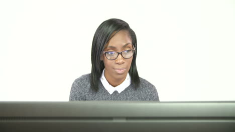 Young-Business-Woman-Working-at-Computer