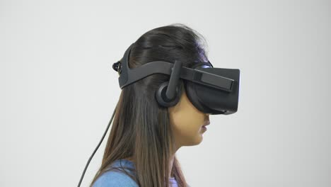 Young-Woman-Looking-Around-in-Virtual-Reality-Headset