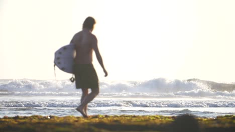 Surfer-Walking-Along-a-Beach