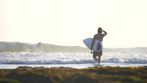 Surfer-Entering-the-Ocean