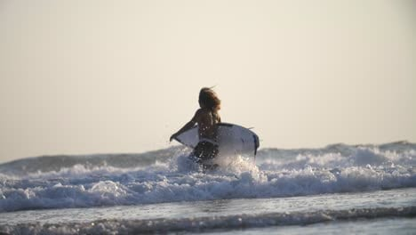 Surfer-Running-into-the-Ocean
