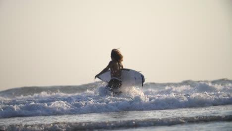 Surfer-Running-into-the-Ocean