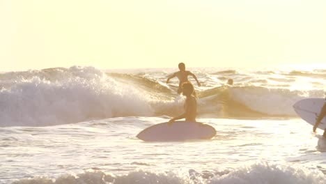 Surfer-Falling-Off-His-Board-at-Sunset