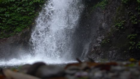 Man-Jumping-into-a-Waterfall