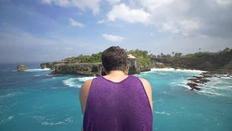 Man-Taking-a-Photo-of-Bali-Coastline