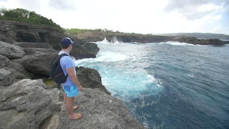 Tourist-Overlooking-Bali-Coastline