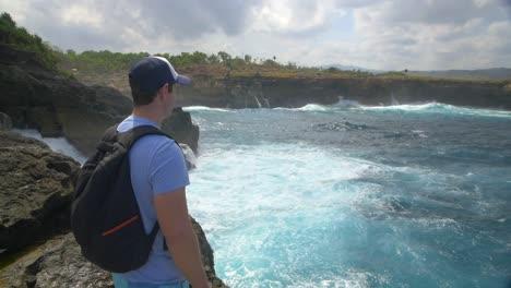Tourist-Overlooking-Rough-Ocean