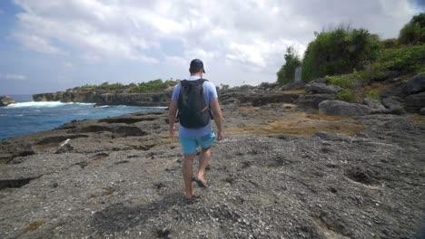 Tourist-Walking-Along-Bali-Coastline