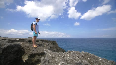 Tourist-Standing-on-a-Rocky-Outcrop