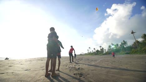 Three-Boys-Flying-a-Kite-on-Beach