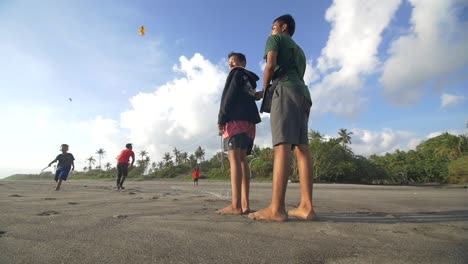 Smiling-Boys-Flying-a-Kite-on-a-Beach