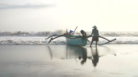 Fisherman-Pushing-a-Canoe-into-the-Sea