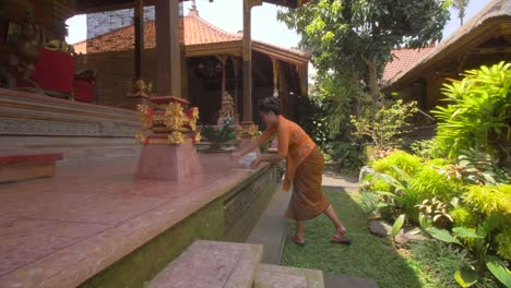 Woman-Arranging-Offerings-in-a-Temple