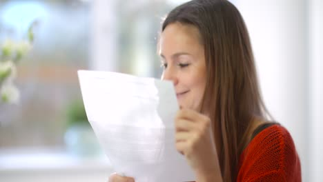 Relieved-Woman-Looking-at-Bills