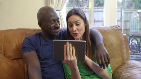 Couple-Using-Tablet-for-a-Video-Call