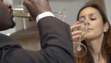 Couple-Drinking-From-Champagne-Glasses