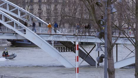 Pedestrians-Walking-Over-Flooded-Bridge-in-Paris