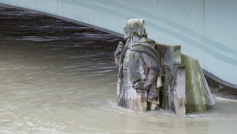 Zouave-Statue-Partially-Submerged-in-Floodwater