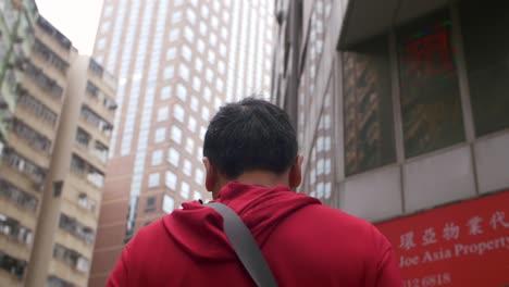 Following-Man-Walking-in-Hong-Kong