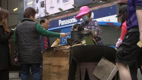 Woman-Paying-Street-Food-Vendor