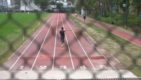 Reveal-Shot-of-Man-Running-on-Track