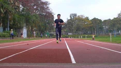 Man-Running-on-a-Racetrack