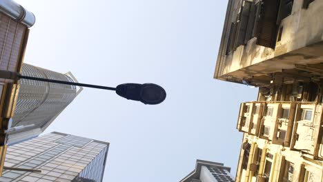 Looking-Up-at-Lamppost-and-Tall-Buildings