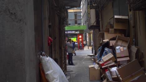Man-Making-Phone-Call-in-Alleyway