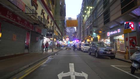 Car-and-Cyclist-in-Hong-Kong