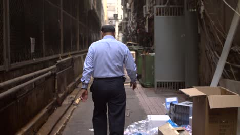 Businessman-Walking-in-Dirty-Alley