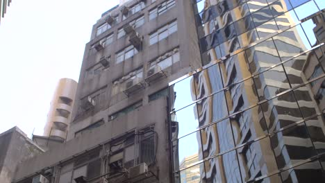 Man-in-a-Jacket-by-a-Skyscraper