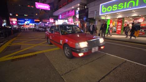 Taxi-Passing-Through-Downtown-Hong-Kong-