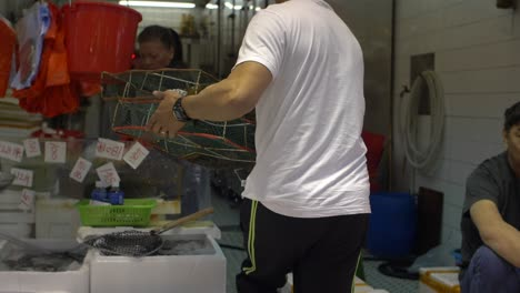 Carrying-Fresh-Seafood-at-Hong-Kong-Market