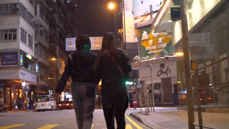Two-Young-Woman-Walking-in-Road