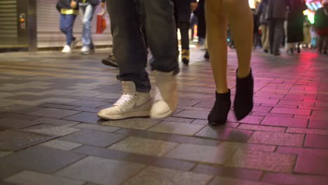 Legs-of-Pedestrians-on-Sidewalk