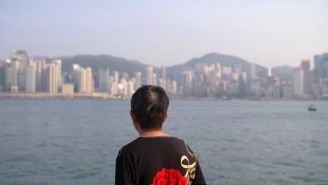 Woman-Overlooking-Victoria-Harbour