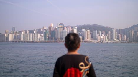 Lady-Overlooking-Hong-Kong-Skyline