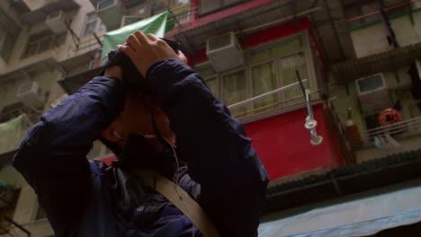 Man-Photographing-Hong-Kong-Tower-Block