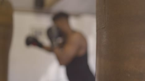 Blurry-Man-Boxing-in-Gym